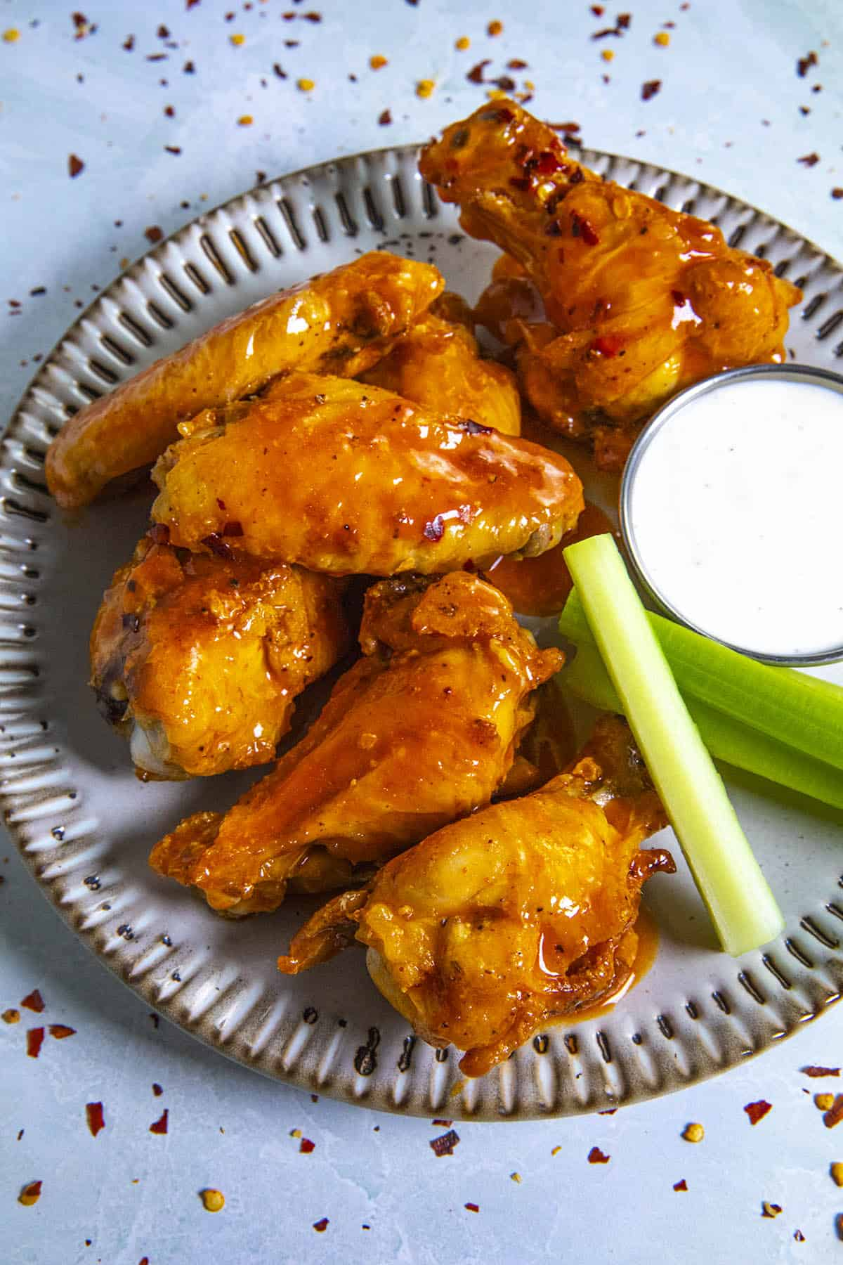 Saucy Buffalo Wings on a plate, ready to serve