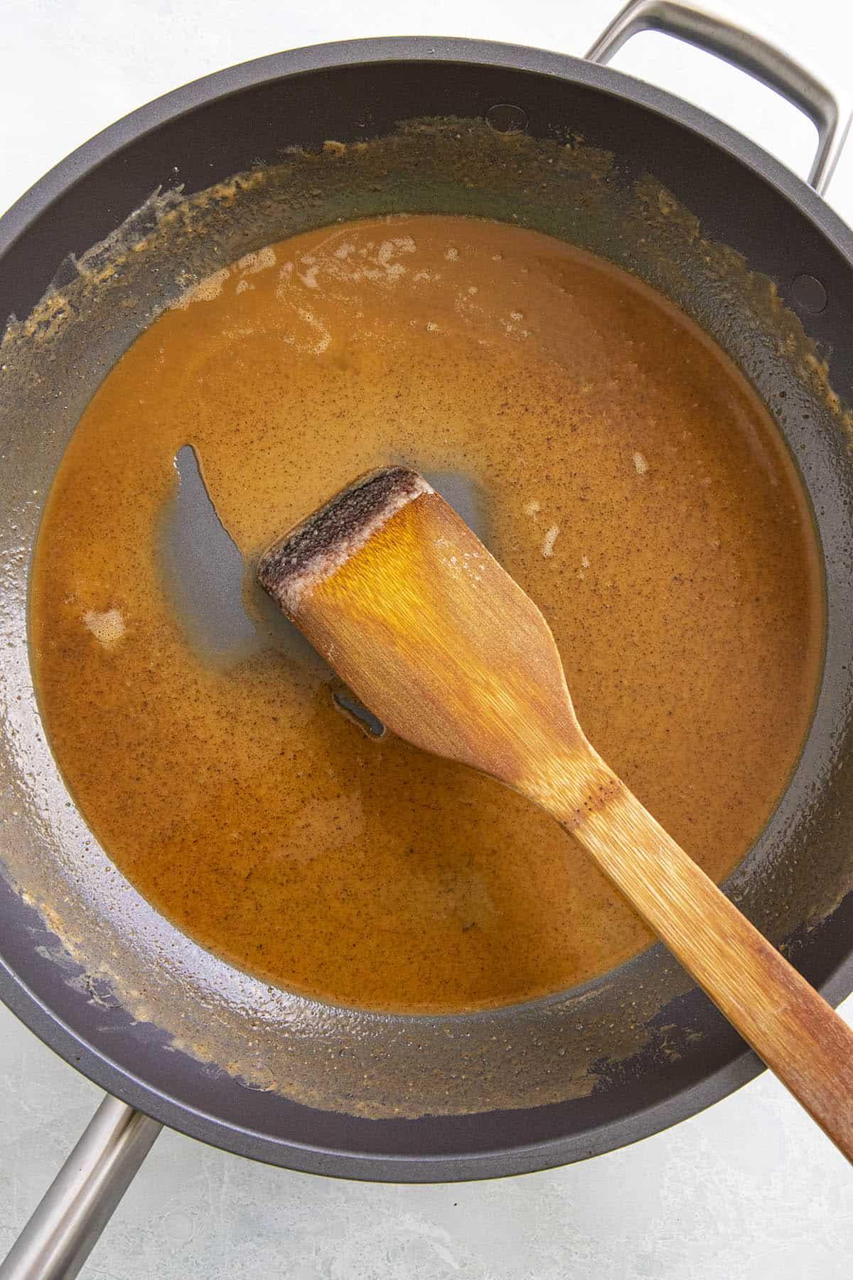 Cooking the roux to make Crawfish Etouffee