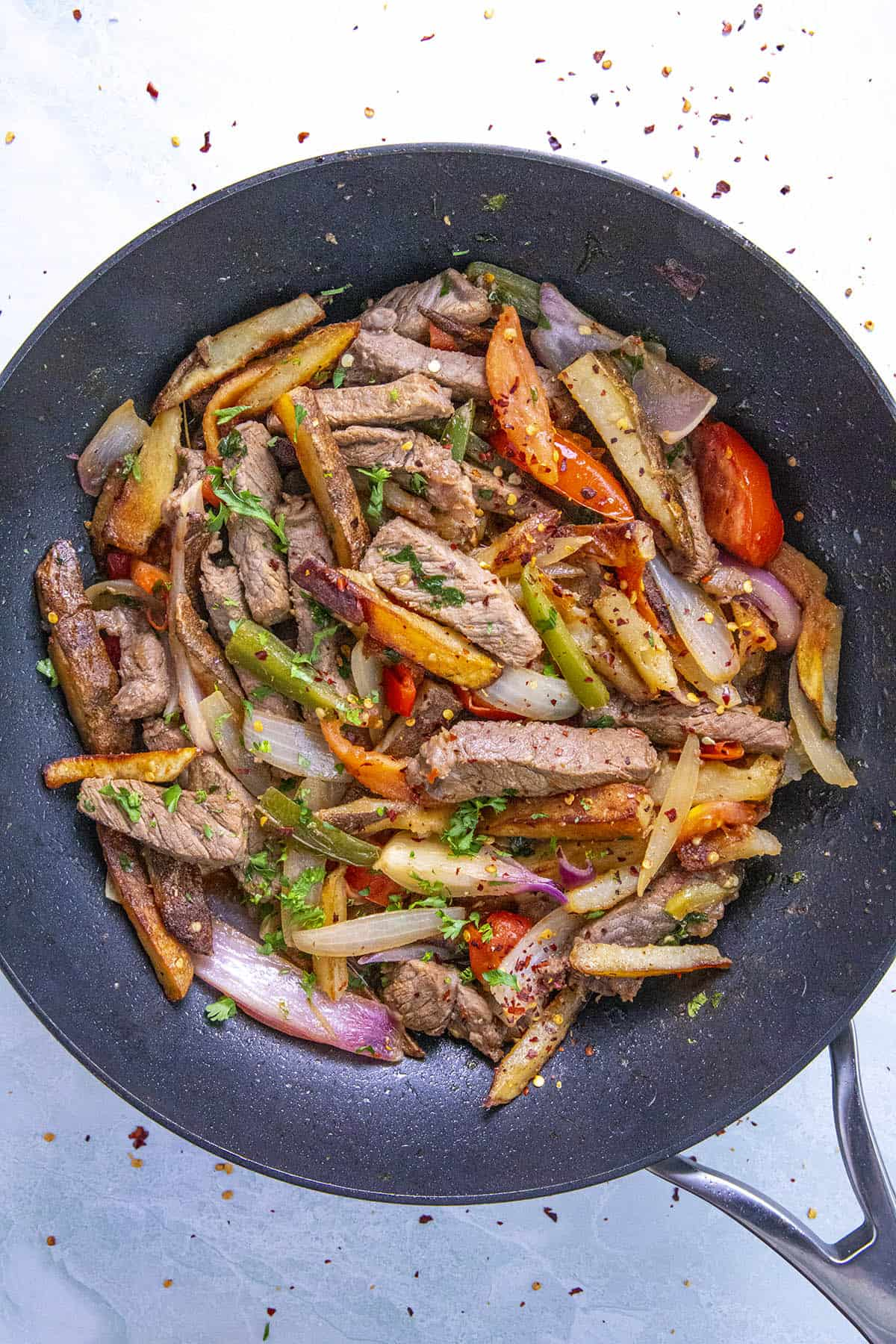 Peruvian Beef Stir Fry with French Fries (Lomo Saltado) in a pan, ready to serve