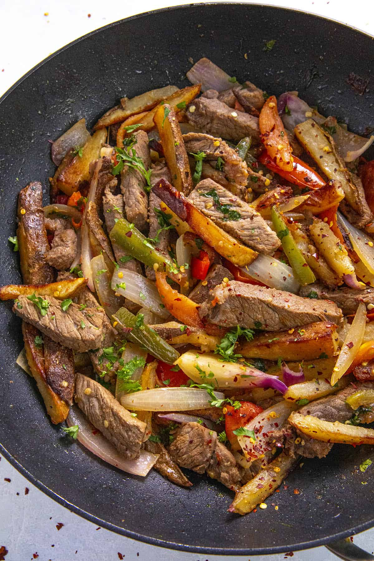 Peruvian Beef Stir Fry with French Fries (Lomo Saltado) in a pan