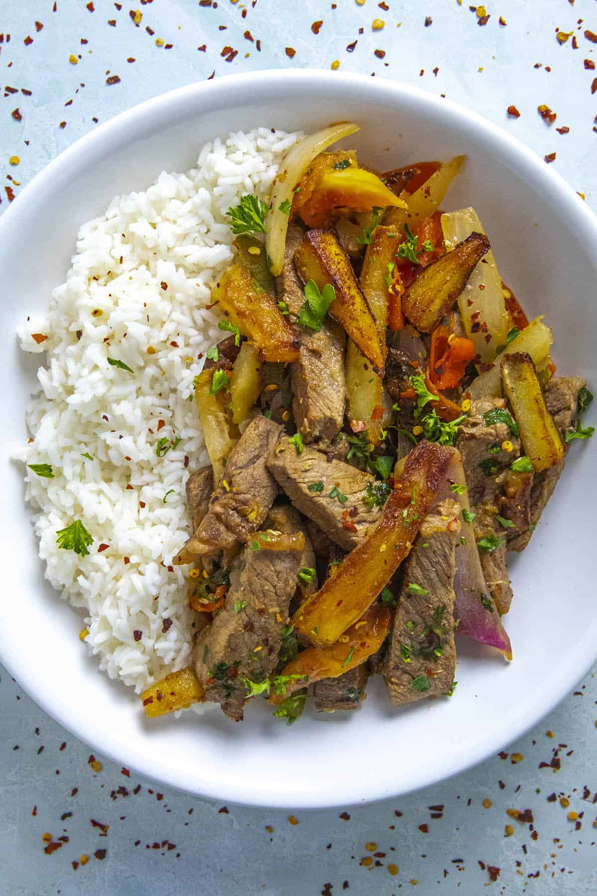 Peruvian Beef Stir Fry with French Fries (Lomo Saltado) in a bowl