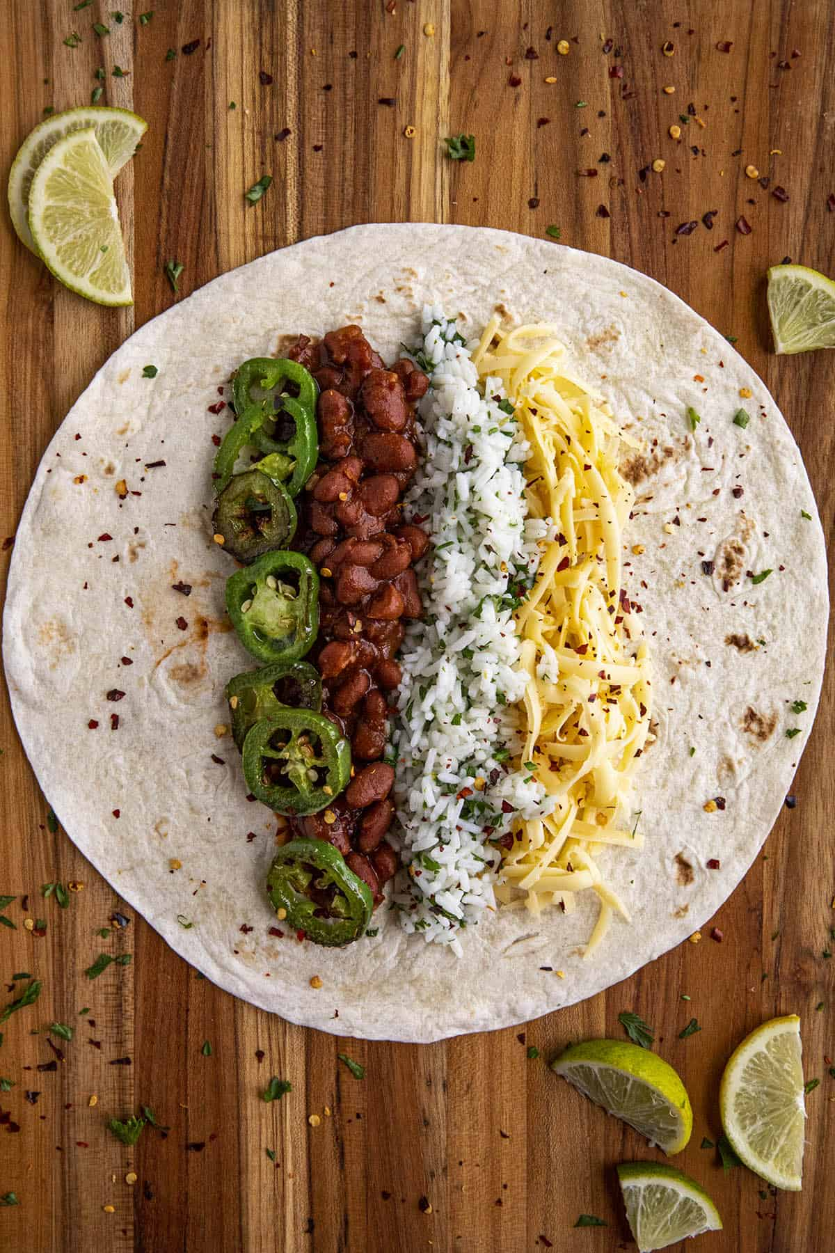 Bean burrito filled with beans, cilaintro-lime rice, cheese and jalapenos, ready to fold
