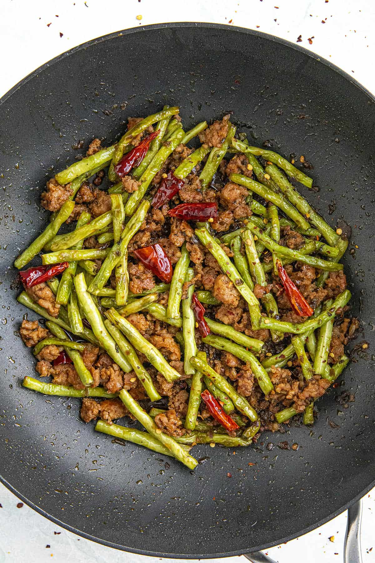 Sichuan Dry Fried Green Beans Recipe in a pan, ready to serve