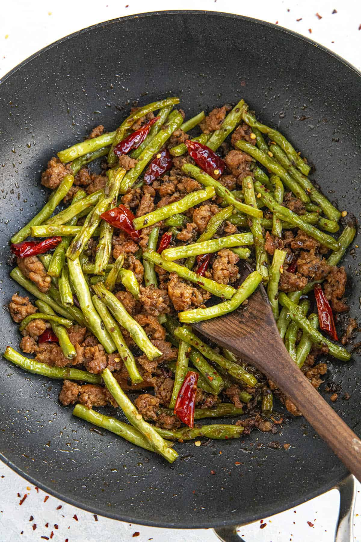 spicy Sichuan Dry Fried Green Beans in a pan, ready for the table