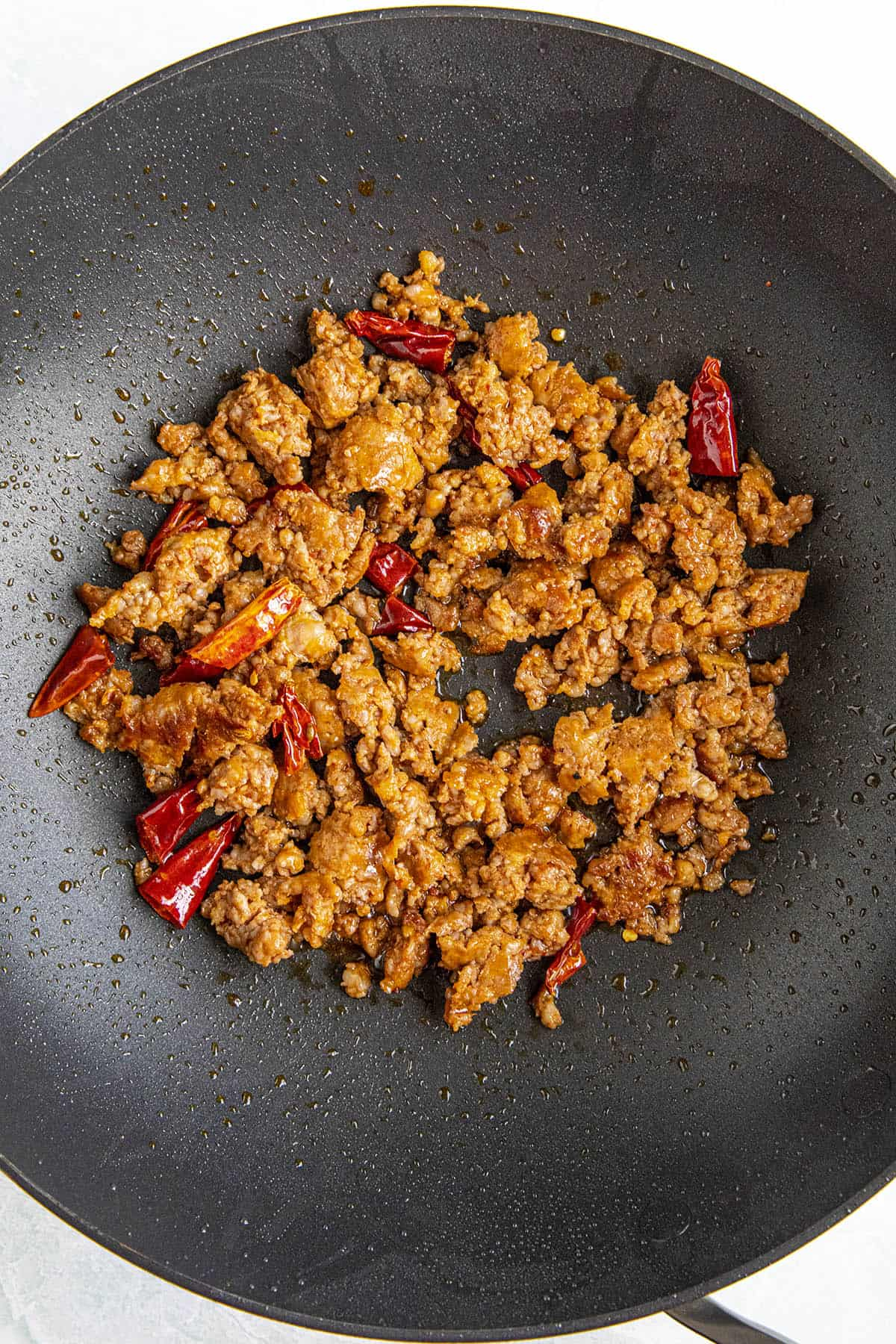 Cooking the pork and peppers in a hot pan
