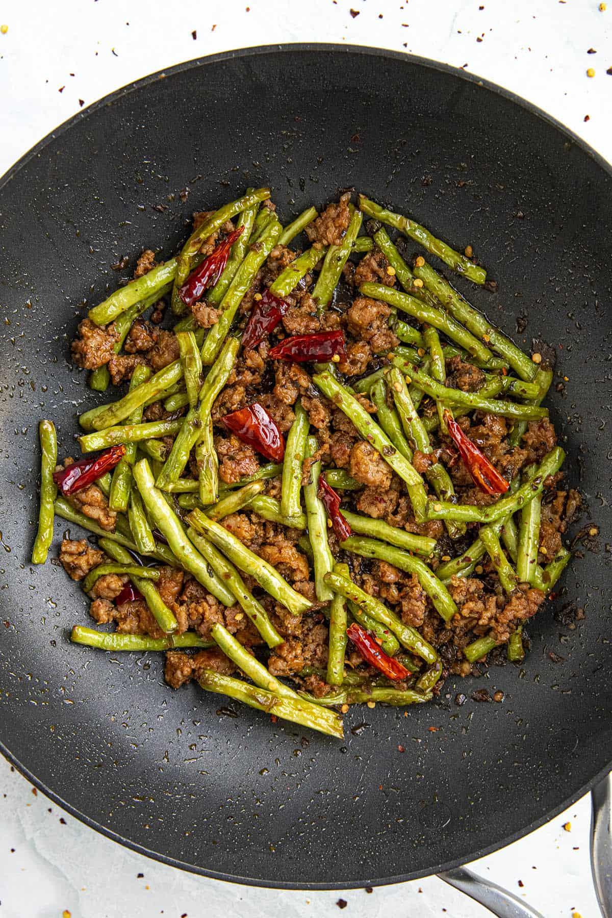 Szechuan Dry Fried Green Beans in a hot pan