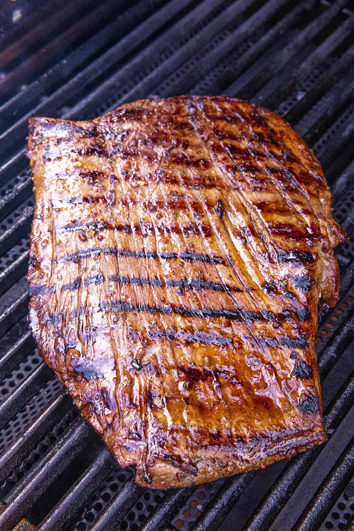 Grilling flank steak on the hot grill