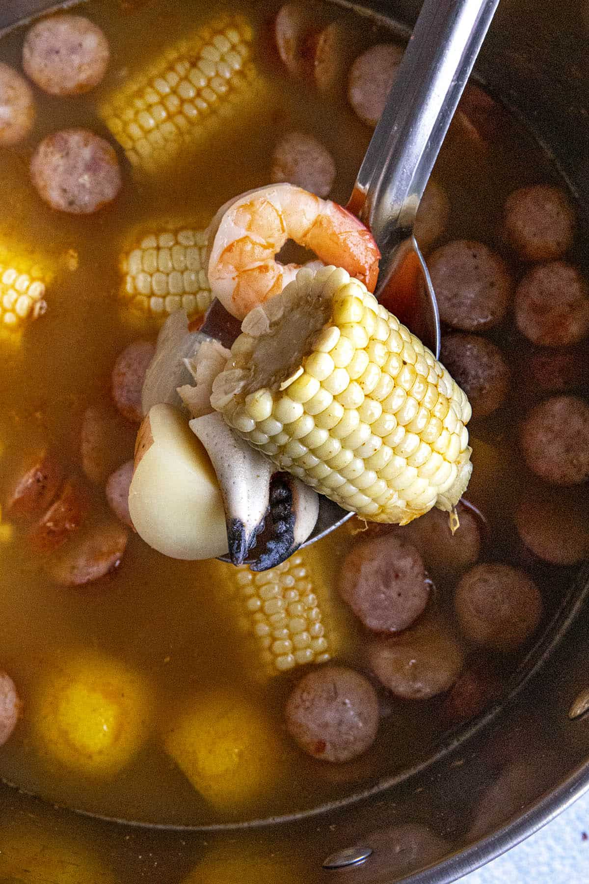 A big scoop of seafood, corn and andouille from my pot of low country boil