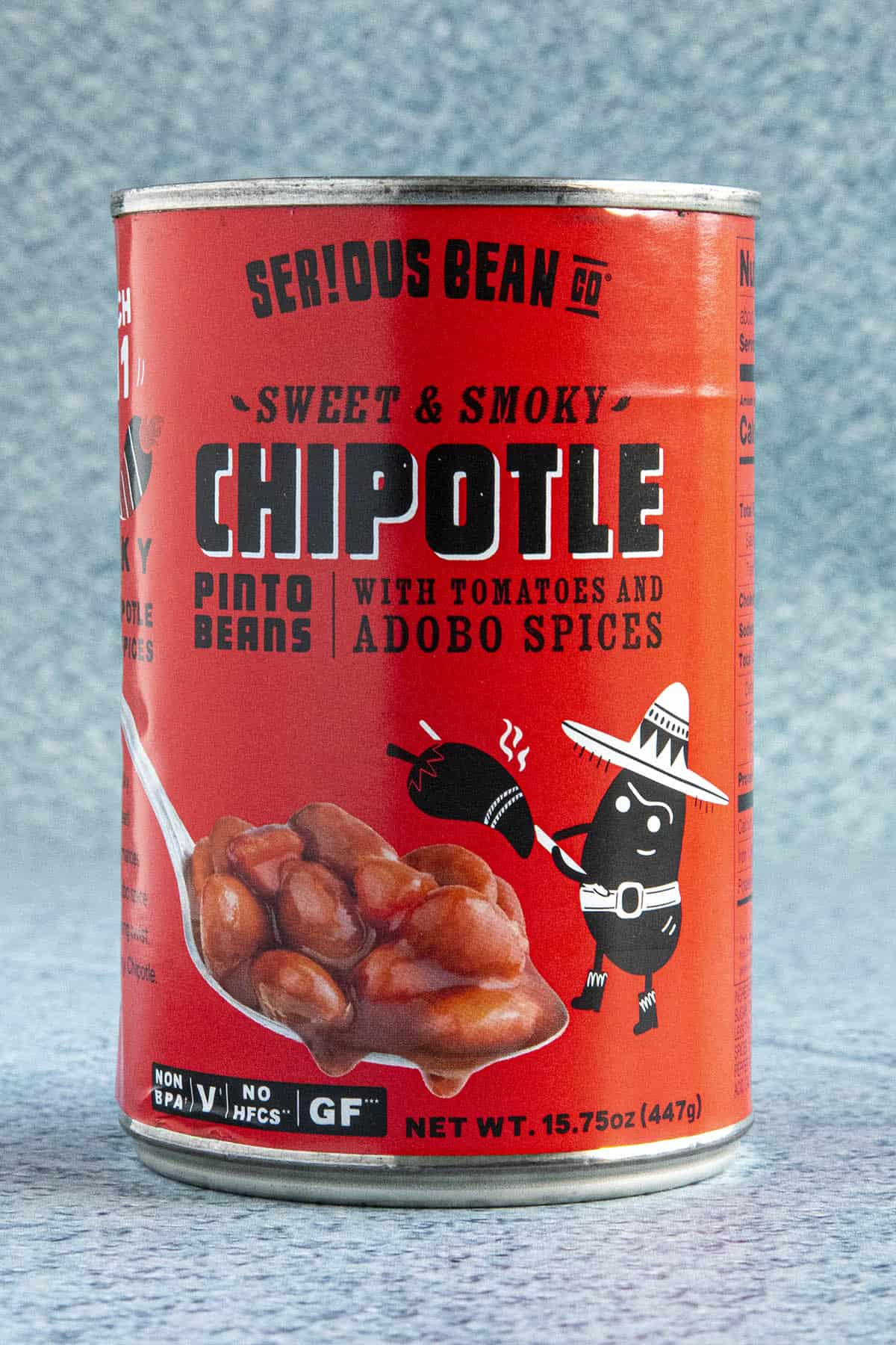 A can of Serious Bean Co. Sweet & Smoky Chipotle Pinto Beans with Tomatoes and Adobo Spices