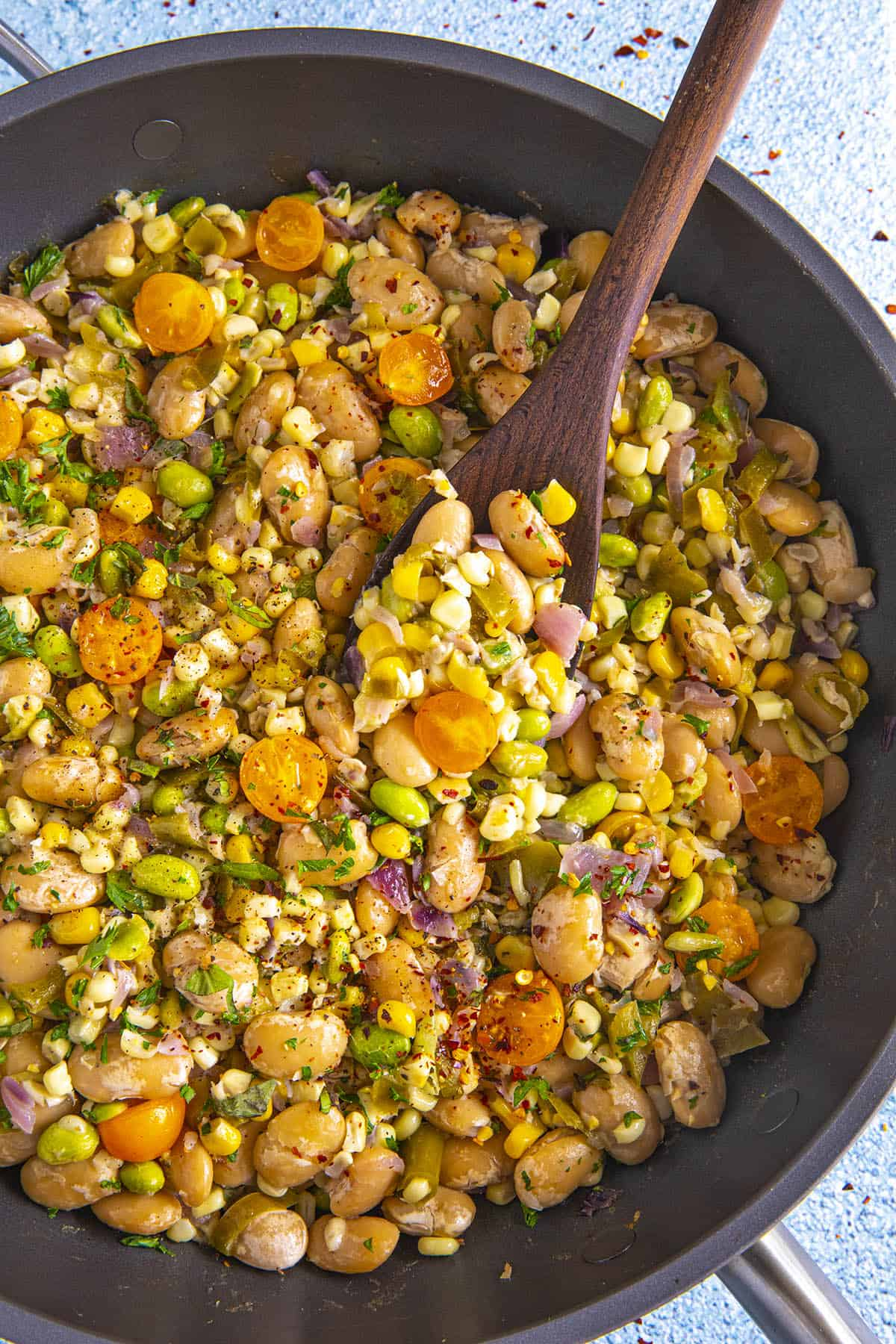 Mike serving a scoop of succotash from the hot pan