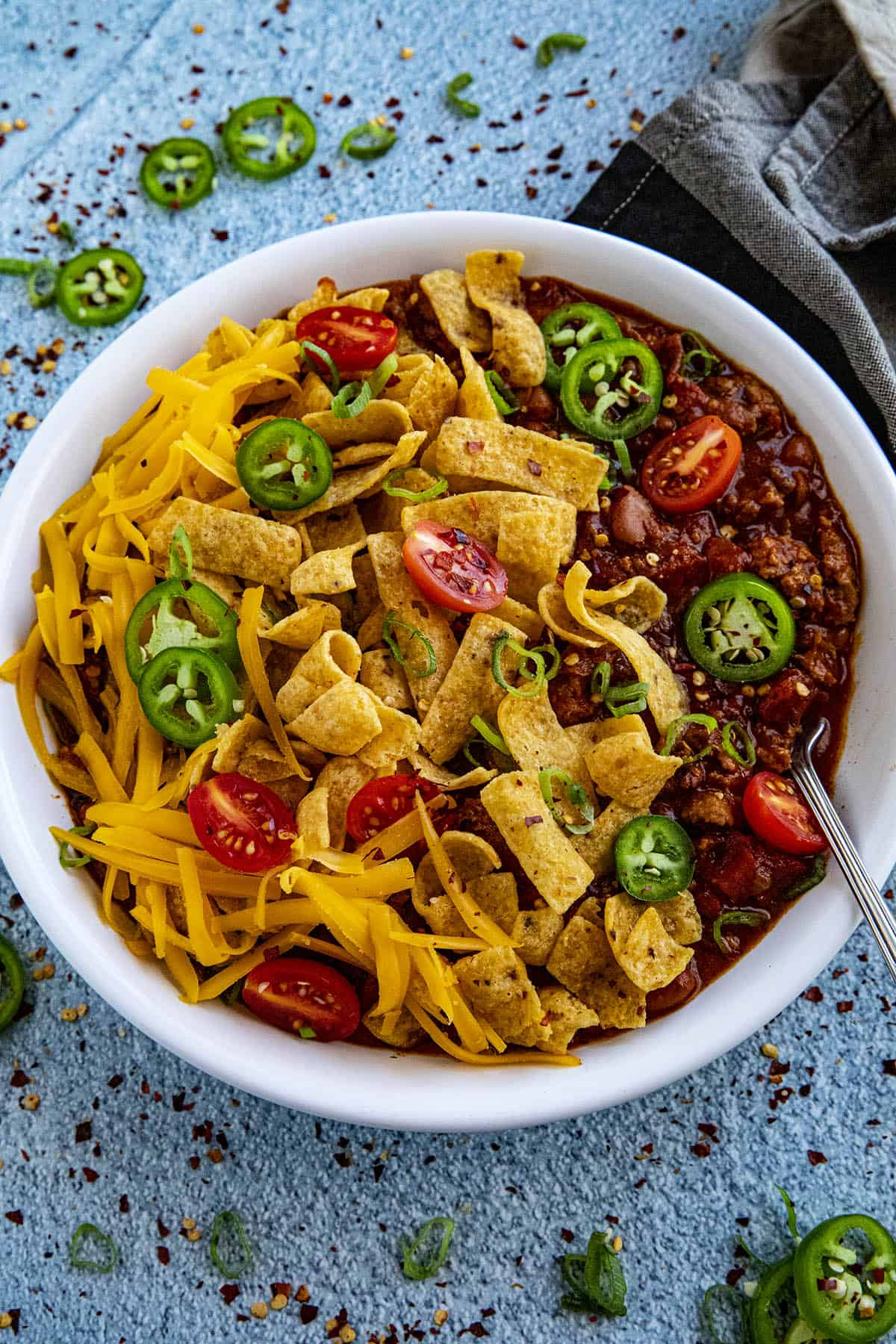 Frito Pie in a bowl with extra peppers