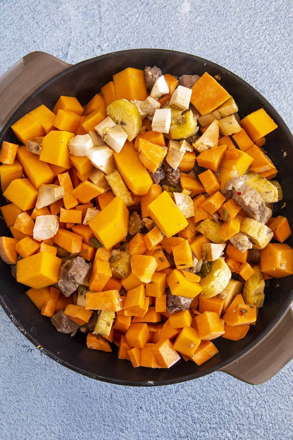 Adding the root vegetables to the pot