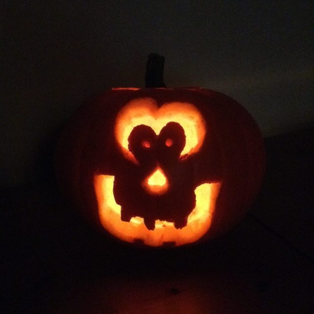 Halloween. Lit pumpkin in the dark