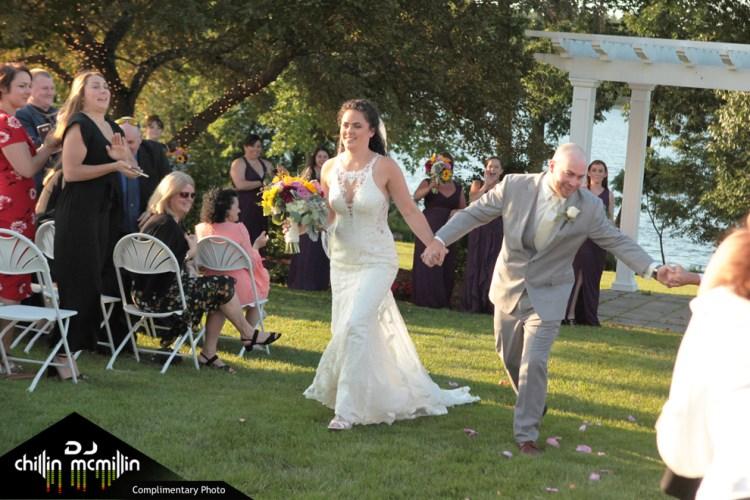 Happy bride and groom exiting wedding ceremony