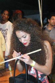 ISADORA SCOTT signs drumstick for fan