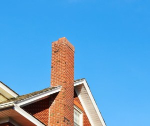 a masonry chimney with blue sky