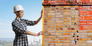 woman taking measurements of chimney bricks