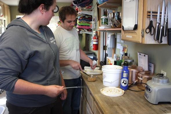 web jen matt vounteers make evening enrichment PVC tubes peanut butter raisins (dm) IMG_2106