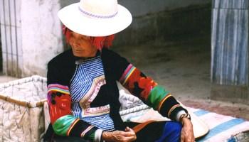 Hani woman - Yuanyang rice-paddy terracing images and video Yunnan China