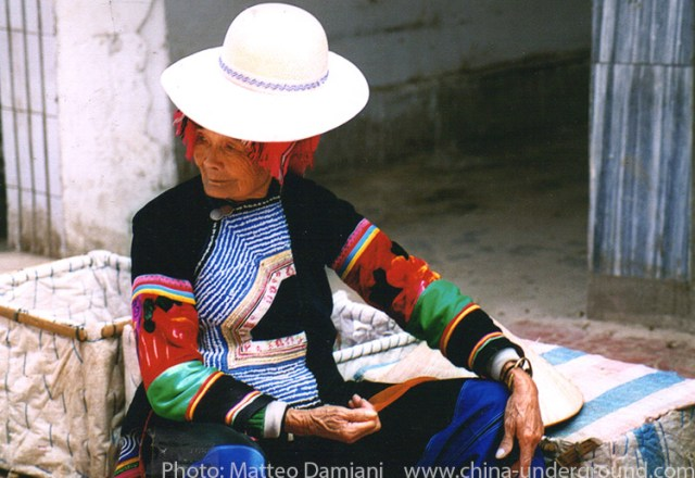 Hani woman - Yuanyang rice-paddy terracing images and video Yunnan China
