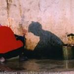 Chinese woman in a village - Yuanyang rice-paddy terracing images and video Yunnan China