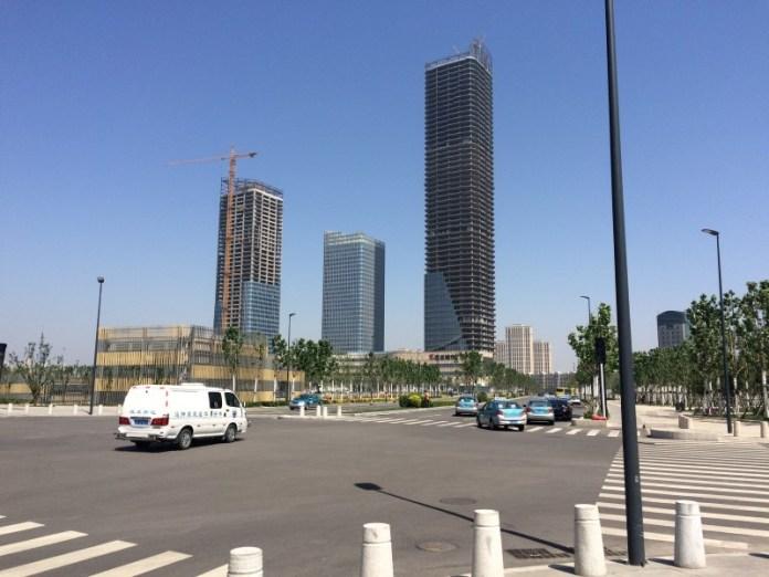 Buildings under construction are seen at Yujiapu in Tianjin, China, May 17, 2016. REUTERS/Sue-Lin Wong