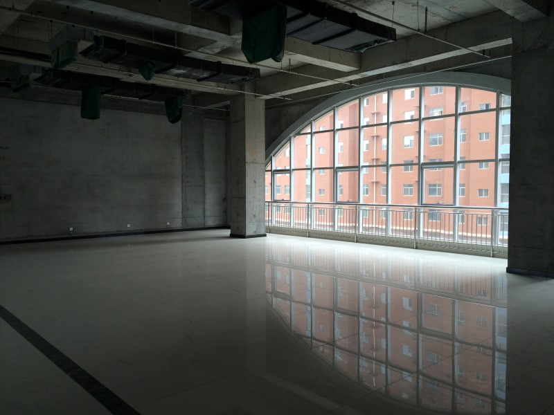 An empty area inside of Hongxiang Building, which houses an incubator for high-tech start-ups, is seen in Shacheng, Hebei Province, China, May 11, 2016. REUTERS/Sue-Lin Wong