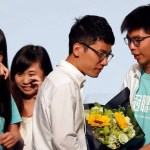 Student leader Joshua Wong (R) greets candidate Nathan Law (2nd R) as supporters share their joy after Law won in the Legislative Council election in Hong Kong, China September 5, 2016.      REUTERS/Bobby Yip