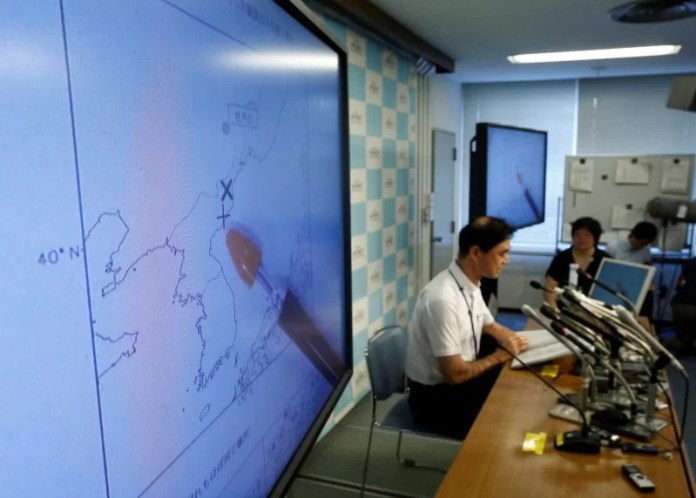Japan Meteorological Agency's earthquake and tsunami observations division director Gen Aoki speaks next to screens showing the seismic event was indicated on North Korea and observed in Japan during a news conference at the Japan Meteorological Agency in Tokyo, Japan, September 9, 2016. REUTERS/Kim Kyung-Hoon
