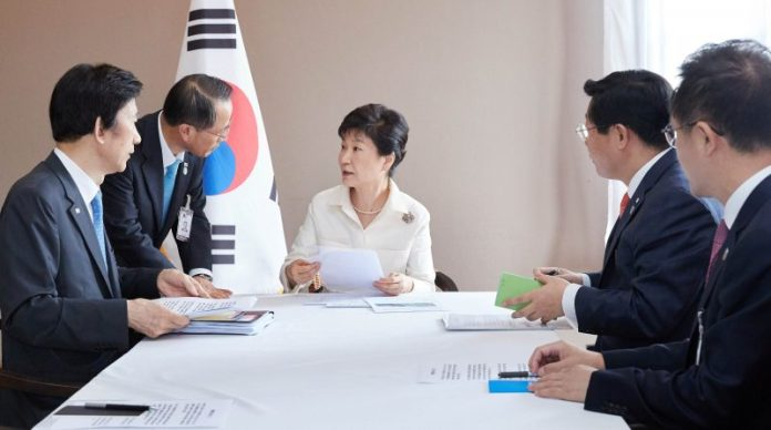 South Korean President Park Geun-hye presides over an emergency meeting at her residence in Vientiane, Laos, in this handout picture provided by the Presidential Blue House and released by Yonhap on September 9, 2016. the Presidential Blue House/Yonhap via REUTERS