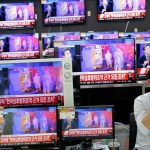 A sales assistant sits next to TV sets broadcasting a news report on North Korea's fifth nuclear test, in Seoul, South Korea, September 9, 2016.  REUTERS/Kim Hong-Ji