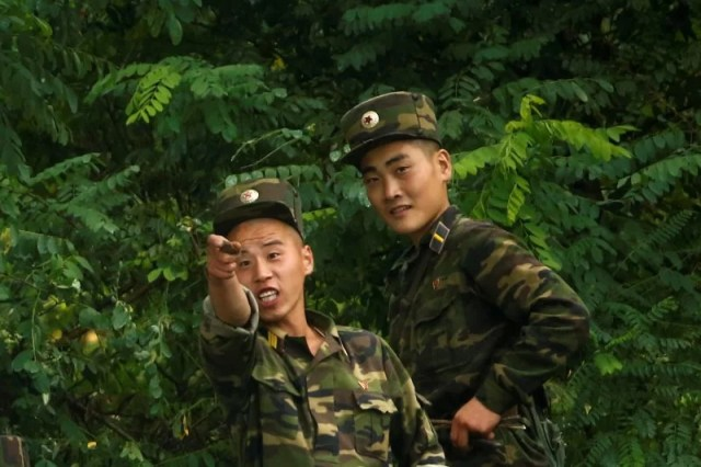 North Korean soldiers keep watch at the bank of the Yalu River, near the North Korean town of Sinuiju, opposite Dandong in China's Liaoning province, September 10, 2016. REUTERS/Thomas Peter