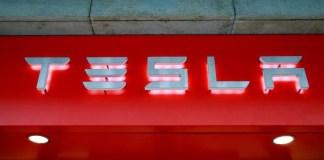 The logo of U.S. car manufacturer Tesla is seen in Zurich