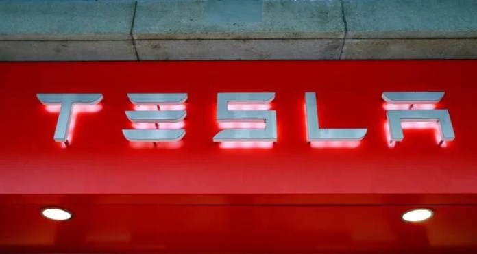 The logo of U.S. car manufacturer Tesla is seen in Zurich