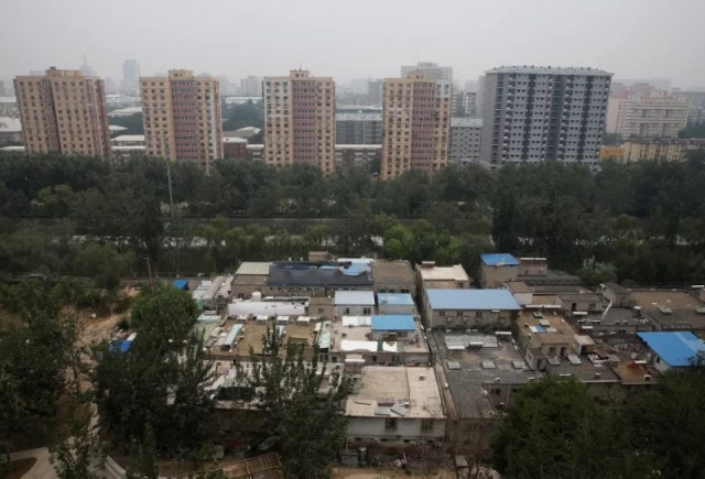A cluster of buildings (front) where some patients and their family members stay while seeking medical treatments is seen in Beijing, China, June 23, 2016. REUTERS/Kim Kyung-Hoon