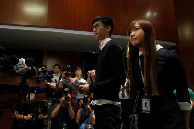 Pro-independence legislator-elects Yau Wai-ching (R) and Baggio Leung meet reporters after the president of the legislature delayed the swearing-in of the two in Hong Kong, China October 25, 2016. REUTERS/Bobby Yip