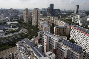A general view of Sunseap Leasing's photovoltaic solar systems on top of Housing & Development Board (HDB) public housing estate blocks in Singapore April 15, 2015. HDB is the largest stakeholder in the installation of solar photovoltaic (PV) system in Singapore. Harnessing solar power from extensive rooftop spaces in HDB blocks help to power common services in HDB blocks, such as lifts and common area lighting.\n\nREUTERS/Edgar Su