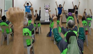Senior citizens are led through a series of upper body exercises by a robot named RoboCoach Xuan 2 at the Lions Befrienders Senior Activity Centre in Singapore June 24, 2016. Supported by Infocomm Development Authority of Singapore and Ministry of Social and Family Development, RoboCoach Xuan 2 is a humanoid social robot designed and developed by Ngee Ann Polytechnic, to function as an exercise coach to guide and motivate senior citizens in their physical exercise and encourage active ageing.\n\nMinistry of Communications & Information via Reuters