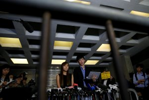Democratically-elected legislators Yau Wai-Ching and Baggio Leung (3nd-R) speak to media after a High Court disqualified them from taking office in Hong Kong, China November 15, 2016. REUTERS/Tyrone Siu
