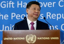 FILE PHOTO: Chinese President Xi Jinping addresses the guests during a gift handover ceremony at the United Nations European headquarters in Geneva