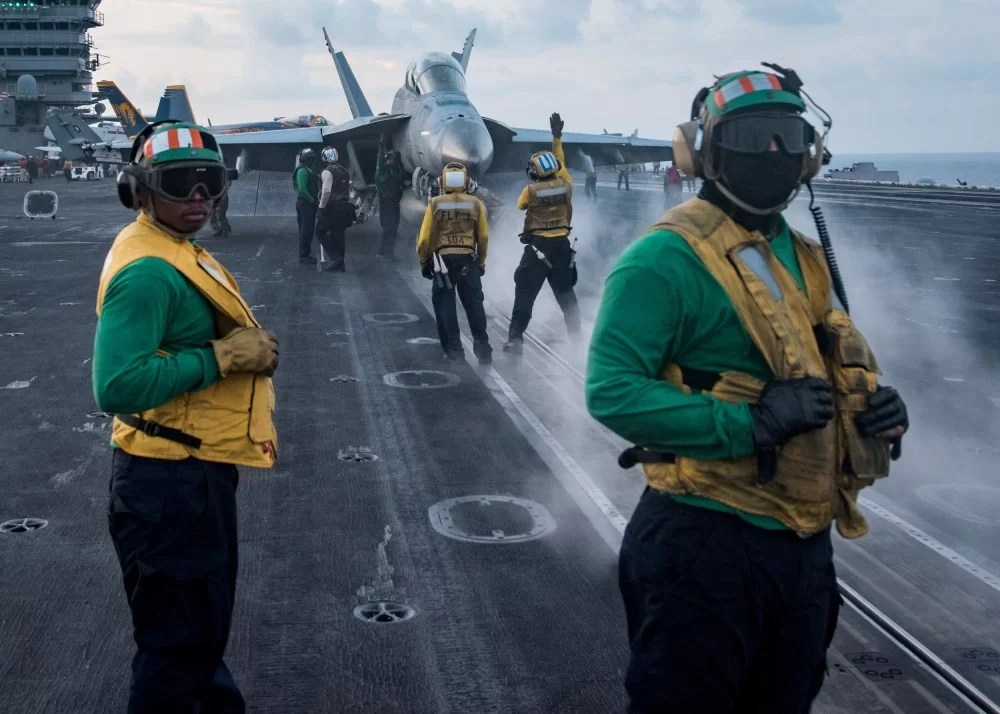 Sailors conduct flight operations on the aircraft carrier USS Carl Vinson flight deck, in the South China Sea
