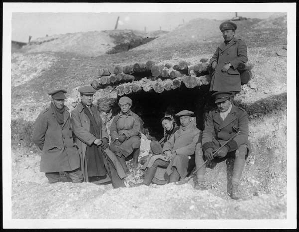 Chinese students on a visit to the British Western Front, outside an old German dug out