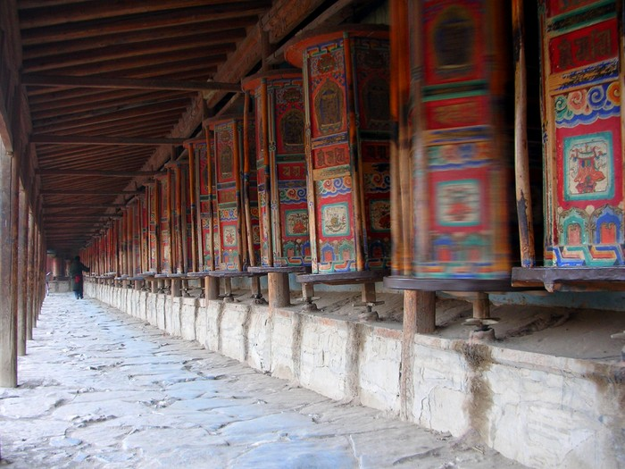 The Labrang Monastery is surrounded on all sides by walls covered in prayer wheels, kept spinning by pious pilgrims.