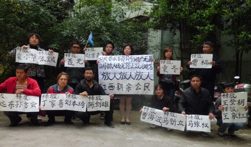 """This was the """"illegal assembly"""" outside Liu Ping's apartment building one early evening in April, 2013."""