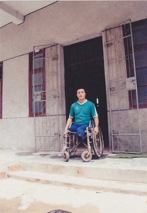 Fang Zheng in front of his apartment in Hainan in 1994.