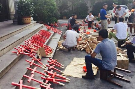 Church members making crosses earlier this year for protest.