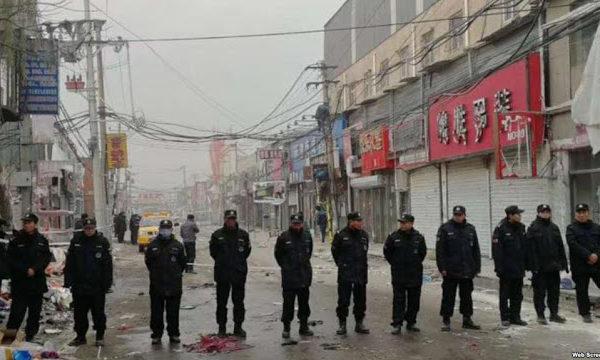 Beijing expulsion, line of police