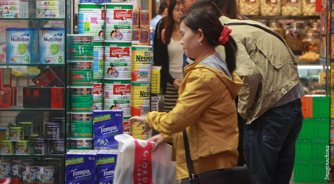 woman supermarket buying infant formula