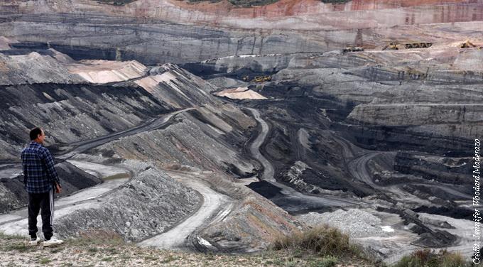 man by open pit mine