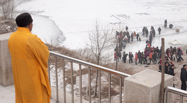 """The booming business of the Buddhist """"life release"""" ceremony"""